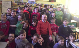 Life's a Pantomime: Principal Denis Griffin on his final day at The Masters with his talented pupils around him. Photograph: Scoil Naomh Charthaigh.