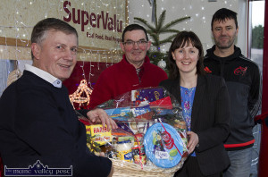2015: Garvey's SuperValu, former Castleisland branch Manager, Margaret Ryan and staff member, John O'Donoghue presenting Christmas Hampers to incoming Castleisland Members' Golf Club Captain, John Manton (left) with club member, Jonathan Kelliher at the Mill Road store before last Christmas. ©Photograph: John Reidy