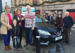 Marion Galvin picking up the keys for her 171 Nissan Pulsar Car which she won in Tralee Credit Union's Members Car Draw from Fintan Ryan CEO Tralee Credit Union, Marcella Herlihy, Tralee Credit Union with David Randles, Randles Bros Tralee.There to support her is her husband Denis Galvin and their family Rachel, Claire, Catriona and Katelyn.