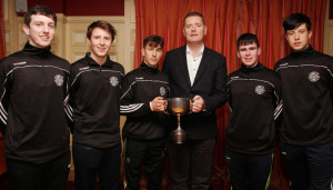 Pictured are Ballymacelligott U-16 players:  Josh O' Keeffe, James Mc Donnell, Daire Keane, Barry Lyons and Tadhg Brick with Kerry County Board Chairman, Tim Murphy at the pre-Christmas medal presentation to the winning Castleisland District U-16 County Championship winning team. Photograph: Tom O'Donoghue