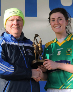 She's the best: Kerry mid-fielder, Lorraine Scanlon receiving the Player of the Match award from Gerard Murphy on behalf of sponsors, Vincent Murphy Sports, Castleisland after Sunday's Ladies NFL game on Sunday.