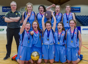 What winning means is clearly written all over the faces of the Pres team with Coach, John Enright at the National Basketball Arena in Tallaght on Wednesday. Front from left: Emma O'Regan, Kayla O'Connor, MVP; Millie Luck, Marlyn Cahill and Gemma Kearney. Back row: Coach Enright, Joyce O'Connor, Áine Sheehan, Gráinne Walsh and Bríd Moriarty. Photograph: Basketball Ireland.
