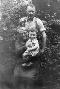 Johnny and Ellen Reidy with their grandson, John Reidy at Knocknagore, Castleisland circa summer 1954