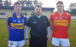 Cordal's Captain, Phillip O'Connor poses for a photo with Referee Maurice Murphy and the  Valentia Young Islanders Captain, John Curran.