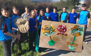 Castleisland Community College students during their clean-up along the River Maine and, inset is a sample of their recycling craft.  Included are from left:  Conor O'Sullivan, Mark O'Donoghue, Greg Curran, Aisling O Connell, Matthew Broderick,  Shauna Ahern, James McDonnell, Eamon Nolan, Danni Reidy, Siobhan Collins and D.J Fealey.