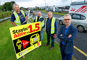 Kerry County Council staff:  Ger Griffin. Tom Casey and Tom O'Sullivan, with the roadside signs for the Stayin' Alive at 1.5 campaign. In foreground is Colin Lacey Editor of Kerry's Eye Newspaper.