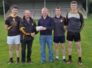 Connie Fitzgerald, Agri Planthire presenting prizes to James Galwey for the Currow Minor 2016/2017 fundraiser. Included are, from left:
