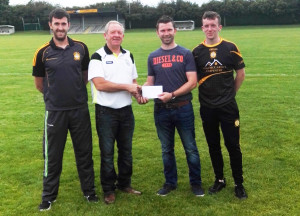 Connie Fitzgerald, Agri Plant Hire presenting prizes to John Buckley for the Currow  GAA Club Minor 2016 2017 fundraising drive. Included are, from left: