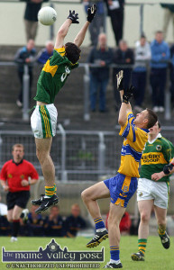 Kerry's Kieran Brennan makes a spectacular leap to fetch this midfield ball ahead of Clare's, Diarmuid Cusack during Wednesday evening's Munster Minor football Semi-Final at Austin Stack Park.   ©Photograph: John Reidy  29/6/2005