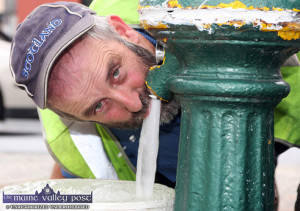 Trial run: Cllr. Danny Healy Rae taking a drink as the water flows from The Fountain in Castleisland after years of drought. ©Photograph: John Reidy 07/08/2009