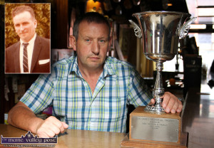 John Cronin pictured in Kate Pats' Bar with the Con Carey Memorial Cup which was donated to Brosna GAA Club by Brosna Town composer, Danny Hannon (inset) The cup will be played for by teams from Brosna and Rockchapel in a rare cross-border encounter on Friday evening. ©Photograph:  John Reidy