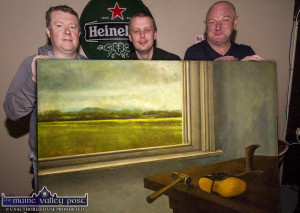 John Carty (left) with Barman, Adrian O'Leary and Pat Jameson with the late Mike Kenny's painting, The Shoemaker on the evening of its rediscovery in The Shoemaker's Bar. ©Photograph: John Reidy 14/06/2017