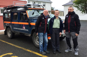 Céilí organiser, John Nolan (centre) pictured with Kerry Mountain Rescue Team members, Mick Long (left) and Mike Ward at Knockgoshel Community Centre. Photograph Courtesy of KMRT.