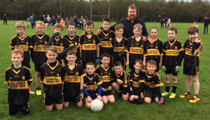 The Currow  U-10 team which won the Castleisland District B Final in Knocknagoshel on Saturday, October 7th. Front from left: David Healy, Ruairi Brosnan, captain; Joshua Ryan, Jack Foley, Sean Dennehy, Conor Clifford, Ben Brosnan and Rory O'Connor. Back from left:  Eric Jensen, Sean Hourigan, Sean O'Sullivan, Anthony Galvin, Daniel McCarthy, Josh Daly, Joe Moriarty, Noel Crowley, Coach;  Harry Crowley, Brid Curtin, Sean Horan and Steven McCarthy.