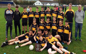 The Currow U-14 team which defeated John Mitchels on Sunday, October 15th. in the Castleisland District League Shield Final in Castleisland. Front from left: John Curtin, Darragh Kelly, Jack Moriarty, Justin McCarthy and Eamon O'Mahony. Middle from left: Liam O'Sullivan, Cathal Brosnan, John O'Connor, Bryan Roche, Cathal Sheehan and Lee Normoyle. Back from left: Con Enright, Mentor;  David Moriarty, Denis Horgan, Raymond O'Neill, Padraig Brosnan, John Ahern, Paddy Howard, Danny Crowley, Adam Healy, Tim Healy and Tone Brosnan, Mentors.