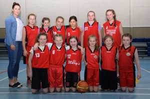 St. Mary's Basketball Club U-12 Division 3 Girls with Coach Tracey Hartnett before their comprehensive win over Caherciveen on Saturday.