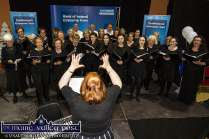 Castleisland Parish Choir conductor, Ailish Walsh and her charges performing at the 2016 Bank of Ireland Enterprise Town Expo at Castleisland Community Centre. ©Photograph: John Reidy