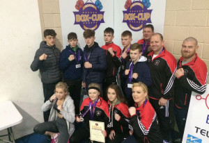 The Sliabh Luachra Boxing Club group at the Box Cup Tournament in Wexford. Included are: Bridget O'Brien, Ava Fitzmaurice, Katelyn Horan and team manager, Jennifer O'Sullivan-Coffey. Back from left: Barry O'Connor, Liam and Paddy Walsh, Paul Browne, Jordan Coffey, Seán O'Brien with coaches: John O'Connell, Barry Walsh and John Coffey.