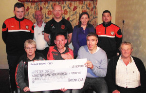 Brosna GAA Club Lotto Presentation: Peter Curtin (centre left) being presented with a cheque for €9,900 by club officials, Kay Walsh and Mikey Walsh with Joe Browne, proprietor of The Three Counties Bar. Back row:  Jack McAuliffe, Mike Brosnan, Micheál Murphy, Joanne Curtin and Tom McGolderick.