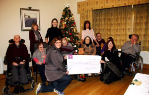 Representatives of Castleisland Camera Club presenting a cheque for €1,300 to management and residents of Glebe Lodge on Saturday. Photograph Courtesy of Castleisland Camera Club