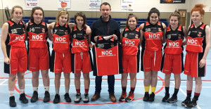 Niall O'Connor, heating and plumbing contractor presenting a set of gear to St. Mary's U-16 girls at Castleisland Community Centre. Included are from left: Muireann Walsh, Katie O'Connor, Saidhbh Prendiville, Abbie Brosnan, Emma O'Regan, Áine Sheehan, Rachel O'Sullivan and Aoife Kerins.