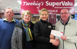 Cllr. Francis Foley receiving a cheque from manager, Ramune Ziliene on behalf of Twohig's Supervalu, Abbeyfeale who were the main sponsors of the Abbeyfeale St. Patrick's Day Parade. Included are: committee members, Raymond Fennelly and Kathleen Collins.