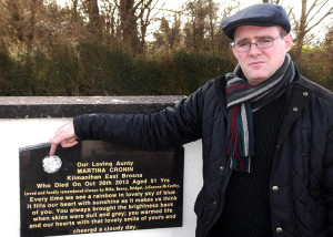 Benny Thade McCarthy with the memorial stone to his late aunt, Martina Cronin which has been tampered with several times over the last few years.