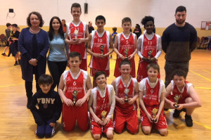 Castleisland Boys National School Basketball team and management after they won the annual  St Anne's National School Blitz on Sunday in Farranfore.  Front from left:  Tadhg Nolan, Mascot; John Daly, Eoghan Shire, Kian Downey, Conor Martin and Charlie Nolan. Back row: Principal,  Marina O'Connor, Marguerite Hickey, coach and teacher;  Brian O'Leary, Evan Brennan, Larry Nolan, Mint O'Connor and  Maurice Lynch, coach and teacher.