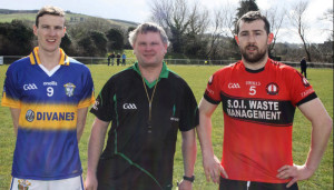 Cordal captain, Philip O'Connor and Tarbert captain, Michael Normile with referee, Tim Brosnan from Lispole pose for a photo before Sunday's game. Photograph: Danny Kelliher.