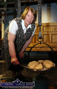 Peggy Reidy baking Griddle Bread during a National Heritage Week demonstration at Browne's Bar.  ©Photograph: John Reidy 24-8-2014