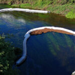 River Maine Oil Spillage Source Identified and Fixed and Collection Booms Deployed