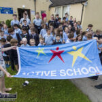 Curranes N.S. Teachers and Pupils Raise a Flag For the Daily Mile
