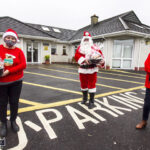 Gift Laden Santa On Tour from Day Care Centre to the Young at Heart